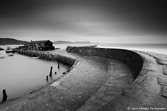 (Claire Hutton) Tags: uk longexposure winter sea blackandwhite bw cold building monochrome wall aquarium mono coast daylight sticks still bend empty smooth s coastal le dorset cobb daytime posts shape wonky hitech 48 lymeregis uneven thecobb mily ndfilter jurassiccoast formatt firecrest 16stop sonya6000 samyang12mm 16stopper