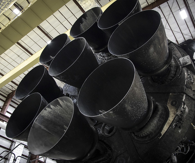 Falcon 9 first stage in hangar; upgraded Merlin engines close-up