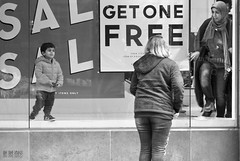 Get One Free (Ian Sane) Tags: street camera boy white black retail oregon canon portland lens ian photography eos is downtown child sale candid mother images 7d usm storewindow mischief shopper sane getonefree ef100400mm f4556l