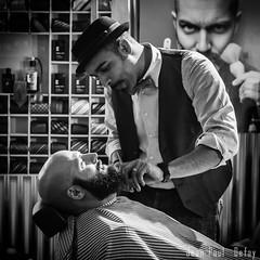 Barber's Diagonal (JP Defay) Tags: portrait people blackandwhite white man monochrome beard noiretblanc streetlife oldschool portraiture barber oldtimer rue bearded homme blackwhitephotos rittratto