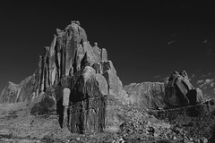 In the Big Rock Candy Mountains (jeneksmith) Tags: vacation sky blackandwhite mountain detail texture nature monochrome rock contrast canon dark landscape grey weird utah natural gray dream surreal roadtrip moab archesnationalpark majestic rugged extraterrestrial americanwest seveneleven redfilter otherworldly canoneos70d