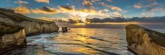 Tunnel Beach Sunrise (grantg59@xtra.co.nz) Tags: ocean sea sky seascape beach clouds sunrise dawn sandstone surf waves tunnel dunedin rays pioneers 1870 tunnelbeach