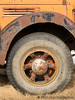 Wheel and Hubcap (Alan Langford) Tags: truck rust industrial tire hubcap oilfield