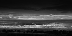 Eldorado At Santa Fe (Mabry Campbell) Tags: sky blackandwhite usa mountain mountains newmexico santafe monochrome clouds dark landscape outdoors photography countryside photo december moody photographer image fav50 unitedstatesofamerica fav20 hasselblad explore photograph 100 fav30 fineartphotography f12 80mm 2015 sangredecristo commercialphotography fav10 flickrexplore fav100 fav200 fav300 explored fav40 fav60 santafecounty fav90 fav80 fav70 hc80 fav500 fav400 sec fav600 fav700 mabrycampbell h5d50c december232015 20151223campbellb0000183