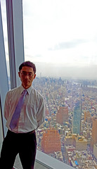 Myself at the observation window (Lost in Flickrama) Tags: city newyorkcity sky skyline clouds buildings high downtown skyscrapers towers landmarks empirestate roads iconic concretejungle