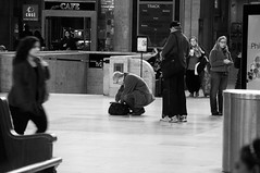 Searching a Bag (John Bense) Tags: street travel urban blackandwhite philadelphia monochrome station train bag pennsylvania luggage pack trainstation traveling 30thstreetstation carry carryon