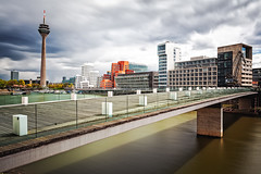 a stroll about the harbor (Blende57) Tags: longexposure architecture harbor cityscape afternoon harbour wideangle dsseldorf frankgehry modernarchitecture duesseldorf medienhafen mediaharbour cityarchitecture mediaharbor