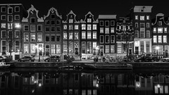 Project Windows (McQuaide Photography) Tags: old city longexposure nightphotography windows winter light urban blackandwhite bw holland reflection window water netherlands monochrome dutch amsterdam architecture night zeiss photoshop vintage outside mono licht canal blackwhite lowlight europe nacht outdoor widescreen sony traditional tripod capital nederland wideangle panoramic ramen fullframe alpha residence 16mm residential 169 redlightdistrict oud stad authentic raam rld manfrotto noordholland gracht lightroom oudezijdsvoorburgwal canalhouse wideanglelens capitalcity 1635mm northholland a7ii grachtenpand groothoek variotessar mirrorless sonyzeiss mcquaidephotography ilce7m2