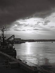 Light waters II (bigalid) Tags: light sunset bw kodak harbour northumbria april kodakbw400cn amble 2016 bw400cn c41 olympuspenee2