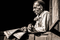 The reader (karmajigme) Tags: travel blackandwhite bw india man monochrome newspaper nikon reader noiretblanc human himachalpradesh