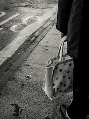 Dank (The Green Hornet ( Manchester)) Tags: street woman bus wet weather bag manchester puddle photography foot shoe high waiting grim documentary gritty stop johnny gr northern chorlton ricoh damp dank stilletto northerns