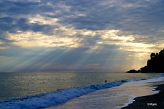 Sunbeams (Kym.) Tags: light sea cloud beach walking spain walk beam andalusia sunbeam nerja andalucia
