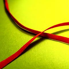 crossed (vertblu) Tags: red macro green redribbon minimal diagonal ribbon minimalism makro hmm macromode vibrancy yellowishgreen vibrantcolours minimalismus macromondays vibrantminimalism vertblu vibrantandminimal