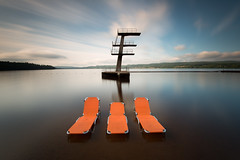 Orange trio (- David Olsson -) Tags: longexposure orange lake 3 seascape water clouds landscape three nikon sweden outdoor august trio fx grad tre dalarna centered vr d800 augusti siljan 1635 2015 ndfilter blackglass sunbeds 1635mm leksand gnd smoothwater divingtower hopptorn solstolar leefilters jumpingtower lenr bigstopper davidolsson solsngar 06hard 1635vr leksandstrand
