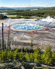 Grand Prismatic Spring (glennlewisphotography) Tags: road travel blue trees summer panorama usa mountain mountains tree nature water america forest landscape volcano nationalpark spring walkway valley yellowstonenationalpark sulphur yellowstone wyoming wilderness volcanic grandprismaticspring glennlewis glennlewisphotography