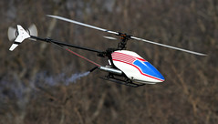 Helicopters Can Have Fun, Too! (jrussell.1916) Tags: blue red flight helicopter kansas redwhiteandblue shawneemissionpark remotecontrolaircraft canon400mmf56lusm