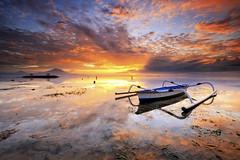Colored Morning (Gede Suyoga) Tags: morning sunset sea sky bali cloud storm seaweed reflection beach nature water beautiful sunrise canon indonesia landscape eos boat asia indah sanur pemandangan waterscape balibeach leefilter leefilters 5dmarkii pantaikarang