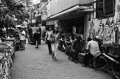 Chess in the Alley (Purple Field) Tags: street people bw film monochrome bicycle rollei analog 35mm walking indonesia alley fuji iso400 together jakarta neopan 40mm 35  schneider kreuznach  presto rollei35  f35          35 canoscan8800f  sxenar  stphotographia   s