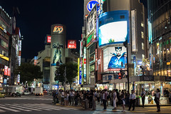 Waiting to Cross (Aymeric Gouin) Tags: voyage street city travel light people signs building japan architecture night dark tokyo lowlight colorful asia neon cityscape crossing crowd shibuya olympus sombre asie foule rue nuit japon ville omd batiment citynight em10 aymgo aymericgouin