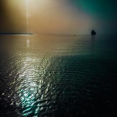 Fifth of May (Melissa Maples) Tags: cameraphone morning sea summer apple water sunrise turkey square boat asia mediterranean ship trkiye 11 cargo antalya lensflare flare sunflare iphone liman  iphone6