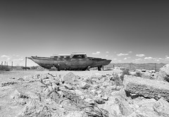 ...And The Water Will Return (autobahn66.com) Tags: old sky blackandwhite hot abandoned water monochrome clouds hope boat ship desert decay fineart surreal dry drought saltonsea bombaybeach monochromia