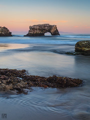 Natural Bridges (lycheng99) Tags: ocean longexposure sunset sky santacruz nature landscape rocks waves pacific dusk bluesky pacificocean pinksky pacificcoast naturalbridges rockformation naturalbridgesstatebeach