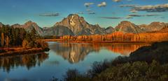 Early Autumn Light (Jeff Clow) Tags: travel autumn reflection fall tourism seasons western wyoming mountmoran grandtetonnationalpark oxbowbend