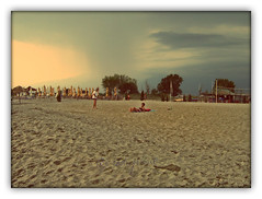 Olympic Beach, Greece (cod_gabriel) Tags: beach rain seaside sand smoke aegean greece grecia litoral aladin seasideresort nisip plaja ploaie olympicbeach plaj statiune staiune pixlromatic photogramio