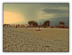 Olympic Beach, Greece (cod_gabriel) Tags: beach rain seaside sand smoke aegean greece grecia litoral aladin seasideresort nisip plaja ploaie olympicbeach plajă statiune staţiune pixlromatic photogramio