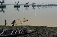 Dusk and Work- Ganges (mainak.guha) Tags: sunset work river evening boat fisherman dusk fishnet westbengal