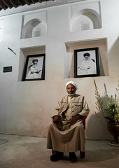old bandari sailor in front of khameini and khomeini portraits in a house, Hormozgan, Bandar-e Kong, Iran (Eric Lafforgue) Tags: portrait people man men senior vertical photography asia sitting iran propaganda muslim islam persia kong indoors human iranian sailor adults adultsonly oneperson middleeastern persiangulf sunni ayatollah menonly seniorman khomeini hormozgan lookingatcamera 50sadult  bandari onemanonly  1people  iro straitofhormuz  colourpicture bandarekong  irandsc05493