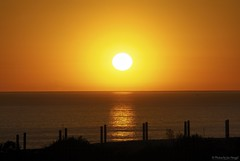 The circle of light.... (Joe Hengel) Tags: ocean sunset sea sky orange seascape yellow fence golden seaside waves glow outdoor horizon shoreline socal shore southerncalifornia orangecounty oc sanclemente seashore theoc goldenhour fenceline goldenstate cloudsstormssunsetssunrises cloudsorangecounty