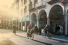The light wasn't that bright, but our eyes were so tired (Jacopo Penna) Tags: world street winter people sun sunlight cold eye heritage bike architecture way photography long exposure arch fuji shadows bright bikes unesco tired mantova flare pancake piazza 40mm wintertime flares mantua erbe warn xt1 xt1gs