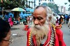 the colourful sadhu with his disciple (sεαη) Tags: nepal india streets lady blessings nikon streetphotography newyearseve hindu kolkata calcutta sadhu happynewyear disciple streetshot westbengal dignified kalighat gorkha kalitemple incredibleindia 18105mm armywife nikond7000 kalighatkalitemple colourfulsadhu gorkhalady