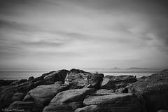 Seascape, Saronic Gulf (Paterdimakis) Tags: ocean travel light shadow sea sky bw cloud black art beach nature water rock landscape blackwhite horizon fine greece geology shape blackwhitephotos