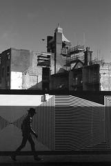 Just a thought (RoryO'Bryen) Tags: stripes demolition cambridge street streetphotography hat cowboy roryobryen rangefinder copyrightroryobryen leicamp leicasummiluxm50f14asph kodaktrix trix rodinal13mins