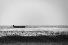 Marina Beach, Chennai, Tamilnadu, India (Naveen Gowtham) Tags: life morning travel light blackandwhite bw india love beach nature monochrome marina canon landscape lost photography mono boat blackwhite seaside alone ngc efs1855mm sealife monotone lonely ng blacknwhite marinabeach chennai seashore tamilnadu bessie nationalgeographic cwc naveen incredibleindia canon600d longestbeach gnaveen chennaiweekendclickers naveensphotography ilovechennai efs1855mmf3556isii naveengowtham naveeng naveengowthamphotography naveenrajgowthaman naveenrajg