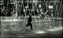 The time of his life (* RICHARD M) Tags: street wet water childhood liverpool fun happy mono blackwhite candid happiness running spray fountains soaking soaked drenched merseyside williamsonsquare soakingwet capitalofculture europeancapitalofculture drippingwet maritimemercantilecity