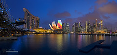 Rainbow Flower (syphrix photography) Tags: travel bridge blue urban building art water skyline museum marina canon river evening bay office singapore long exposure cityscape waterfront dusk district icon science commercial hour helix sands financial 6d 2016 ilight syphrix