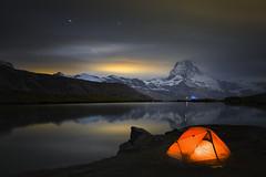 A Night by the Lake (a galaxy far, far away...) Tags: nightphotography water night mood nightscape atmosphere tent zermatt matterhorn alpinelake cervin cervino mirrorreflection stellisee