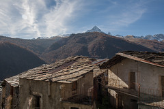 il Monviso sopra le case di Ostana (Clay Bass) Tags: autumn trees light mountains clouds buildings natural canon5d 24mm baita monviso ostana
