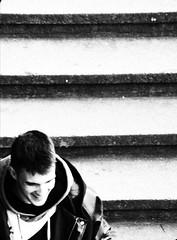 spring (lu.glue) Tags: street city light urban man guy smile stairs grey gris licht downtown strada grigio lumire strasse grau basel treppe uomo stadt mann rue birdseyeview luce lu homme citt vill basle ragazzo basilea ble scaliers luglue