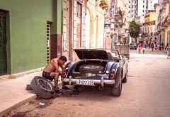 Streets of Havana - Cuba (IV2K) Tags: street classic zeiss sony havana cuba centro castro fidel caribbean cuban habana mechanic kuba fidelcastro lahabana cintage rx1