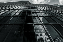 Reflection ( Esther ) Tags: nyc newyorkcity sky blackandwhite ny newyork reflection building window skyscraper canon lens manhattan wide nuevayork canon7d