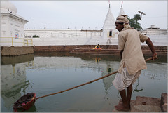 trash collector, amarkantak (nevil zaveri (thank you for 10million+ views :)) Tags: portrait people india man reflection men water trash work river religious temple photography photo blog worship shrine photographer photos geometry prayer religion pray stock images holy photographs photograph rivers offering mp geometrical meditation zaveri source pilgrim stockimages peopleatwork ghat narmada nevil kund madhyapradesh amarkantak nevilzaveri