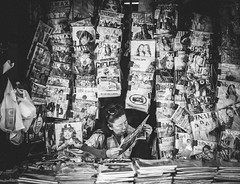 The Read (gus.kovac) Tags: street blackandwhite monochrome shop lady thailand photography newspapers read