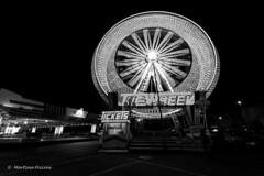 Ferris wheel lights (martinapiccini) Tags: italy spring nikon long exposure streetphotography ferriswheel bnw fvg monocrome udine samyang festadiprimavera