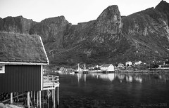 a Life by the Drop (lunaryuna (off to Iceland for 2 weeks)) Tags: bw seascape mountains monochrome norway landscape boats coast blackwhite lunaryuna lofotenislands rorbuer norwegiansea kvalvik traditionalliving fishermenhuts reinefjorden lofotenwall lofotenarchipelago