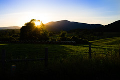 Sunset in the Virginia Mountains (timthulson) Tags: trees sunset sky mountain green field grass virginia spring bales