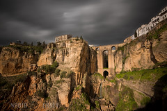 Dark Clouds - Ronda, Spain (N+C Photo) Tags: world life new old travel bridge sky espaa white holiday history tourism blanco architecture clouds rural speed puente photography golden town spain arquitectura nikon europe long exposure mediterranean village slow image earth pueblo culture canyon medieval andalucia structure cliffs architectural historic adventure explore spanish filter ronda cielo hour nubes nd shutter nikkor dslr andalusia malaga learn nuevo architectuur global density iberia discover espaol d800 andaluz neutral reconquista 1635f40